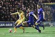 Sutton United Maxime Biamou (24) breaks away from AFC Wimbledon defender & captain Barry Fuller (2) and AFC Wimbledon defender Chris Robertson (34) during the The FA Cup third round replay match between AFC Wimbledon and Sutton United at the Cherry Red Records Stadium, Kingston, England on 17 January 2017. Photo by Stuart Butcher.