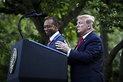 President Donald Trump presents the Presidential Medal of Freedom to Tiger Woods during a ceremony in the Rose Garden of the White House on May 6, 2019 in Washington, DC. (Photo by Oliver Contreras/SIPA USA)