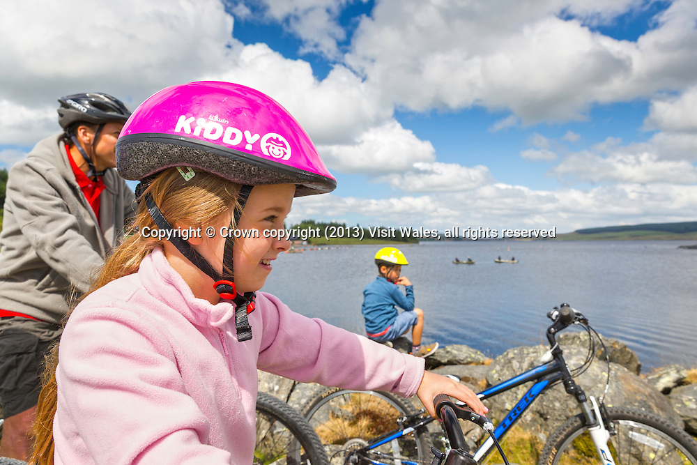 Family pausing to enjoy view over lake<br /> Llyn Brenig<br /> Cycling<br /> Conwy / Denbighshire <br /> North<br /> Cycling<br /> Activities and Sports