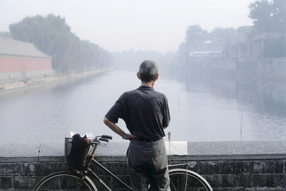 Beijing, China, 2007. Fishing in the early morning in front of the Forbidden City.