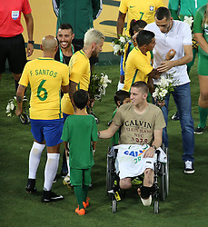 RIO DE JANEIRO, Jan. 26, 2017  Brazilian Chapecoense footballer Jackson Follmann (front R), survivor of the LaMia airplane crash in Colombia, greets a boy before a friendly match between Brazil and Colombia at the Engenhao Stadium in Rio de Janeiro, Brazil, on Jan. 25, 2017. All the net income of the match will be passed on to the Chapecoense Football Association. (Credit Image: © Li Ming/Xinhua via ZUMA Wire)