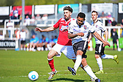 Bromley Midfielder George Porter clears from Wrexham Defender Mark Carrington during the Vanarama National League match between Bromley FC and Wrexham FC at Hayes Lane, Bromley, United Kingdom on 8 April 2017. Photo by Jon Bromley.