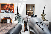 Tokyo, April 10 2014 - An old man looking inside a torpedo on display at the Yushukan, Yasukuni's war museum.