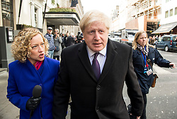 © Licensed to London News Pictures. 09/04/2016. London, UK.  BORIS JOHNSON being questioned by a reporter as he leaves the Conservative Party Spring Forum in central London.  Conservative party leader and British prime minster David Cameron has come under pressure after it was revealed that he had  investment in an offshore fund.  Photo credit: Ben Cawthra/LNP