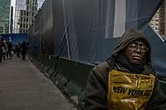 Newspaper vendor naps near Grand Central Station.  New York, New York, USA