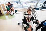Luke Olson performs rehab exercises with the Armeo Spring rehabilitation machine at Gillette Children's Speciality Healthcare in St. Paul, Minnesota, Thursday, Aug. 22, 2019.