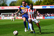 Craig Braham-Barrett holds off Mark Ellis during the Sky Bet League 2 match between Cheltenham Town and Shrewsbury Town at Whaddon Road, Cheltenham, England on 25 April 2015. Photo by Alan Franklin.