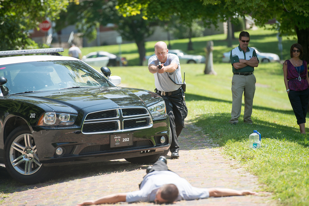 Ohio University Police officer Kevin Frith (Center) participates in active shooter training with Lieutenant Tim Ryan, (Right) at the Ridges. Photo by Ben Siegel/ Ohio University