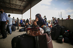 August 15, 2017 - Gaza, Palestinian Territories, Palestine - A Palestinian woman waits to cross the Rafah Border crossing with her luggages, in Rafah in the southern Gaza Strip, on August 16, 2017. (Credit Image: © Sameh Rahmi/NurPhoto via ZUMA Press)