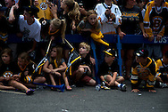 June 18, 2011, Boston, MA - A group of young fans decided to sit down before the parade began. Photo by Lathan Goumas.
