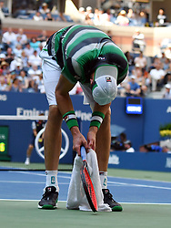 September 4, 2018 - Flushing Meadow, NY, U.S. - FLUSHING MEADOW, NY - SEPTEMBER 04: John Isner (USA) in suffers from blazing hot temperatures in Flushing Meadow during his quarter-final match against John Isner (USA) in the Men's Singles Championships of the US Open on September 4, 2018, at the Billie Jean King Tennis Center in Flushing Meadow, NY. (Photo by Cynthia Lum/Icon Sportswire) (Credit Image: © Cynthia Lum/Icon SMI via ZUMA Press)
