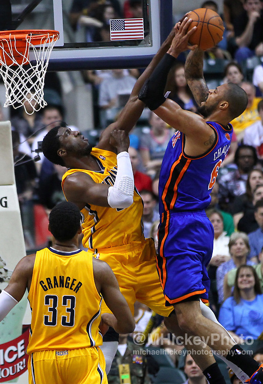 April 03, 2012; Indianapolis, IN, USA; Indiana Pacers center Roy Hibbert (55) goes up to block the shot of New York Knicks center Tyson Chandler (6) at Bankers Life Fieldhouse. Mandatory credit: Michael Hickey-US PRESSWIRE