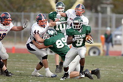 10 November 2007:  The Titan Offensive line clears a hole for Marcus Dunlop. This game between the Wheaton College Thunder and the Illinois Wesleyan University Titans was for a share of the CCIW Championship and was played at Wilder Field on the campus of Illinois Wesleyan University in Bloomington Illinois.