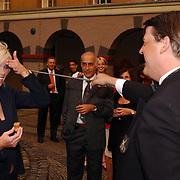Bridget Maasland doorJeroen van Craaikamp, Ambassadeur des Pay-Bas, geslagen als Sabreur in de Orde van Confrerie du Sabre d'Or, Tijdens opening  Cousteau-expostie Scheepvaartmuseum Amsterdam