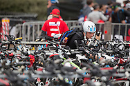 Age Group Competitors Prepare their Bikes And Equipment, March 22, 2014 - Ironman Triathlon : Ironman Melbourne Pre-Race, Frankston Transition, Melbourne, Victoria, Australia. Credit: Lucas Wroe