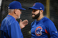 Aug 12, 2017; Phoenix, AZ, USA; Chicago Cubs manager Joe Maddon (70) talks with catcher Alex Avila (13) during batting practice for the MLB game against the Arizona Diamondbacks at Chase Field. Mandatory Credit: Jennifer Stewart-USA TODAY Sports