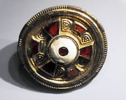 jewelled disc brooch in gilt, silver and garnet. Found Chatham Lines, Kent, England.