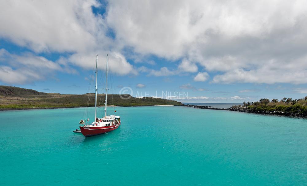 Sail boat anchored in Barrington Bay, the island of Santa Fe, Galapagos.