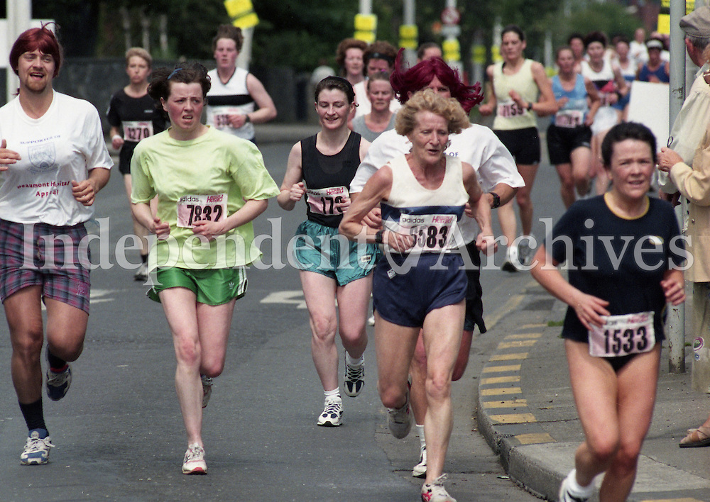 1998 Women's Mini Marathon sponsored by the Evening Herald, 7/6/98..<br /> Runners on the road.<br /> Pic: Ray Cullen.<br /> (Part of the Independent Newspapers Ireland/NLI Collection).