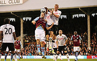 Football - 2012 / 2013 Premier League - Fulham vs. Aston Villa<br /> Ron Vlarr of Aston Villa, John Arne Riise and Brede Hangeland of Fulham all jump for the ball