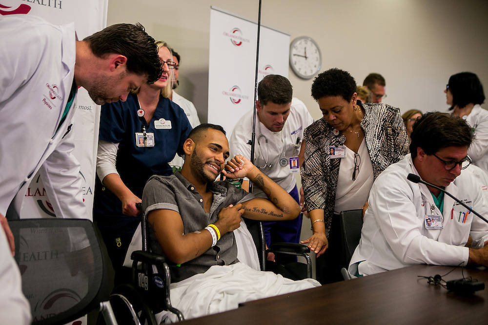 ORLANDO - JUNE 14, 2016: Angel Colon, who survived the mass shooting at Pulse nightclub, speaks alongside Medical staff from the Orlando Regional Medical Center, where he was treated, in Orlando, Florida. CREDIT: Sam Hodgson for The New York Times.