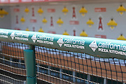ANAHEIM, CA - JULY 21:  The team logo and corporate logos adorn the dugout wall and fence prior to the Los Angeles Angels of Anaheim game against the Texas Rangers on July 21, 2011 at Angel Stadium in Anaheim, California. The Angels won the game in a 1-0 shutout. (Photo by Paul Spinelli/MLB Photos via Getty Images)