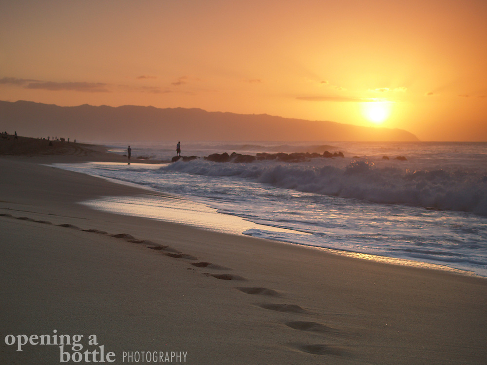 Sunset off Ehukai Beach Park, North Shore of Oahu, Hawaii. This scene is just down the beach from the world-famous Bonzai Pipeline.