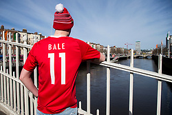 DUBLIN, REPUBLIC OF IRELAND - Friday, March 24, 2017: A Wales supporter wearing bobble hat on the Ha'penny Bridge in Dublin ahead of the 2018 FIFA World Cup Qualifying Group D match against Republic of Ireland. (Pic by Paul Greenwood/Propaganda)