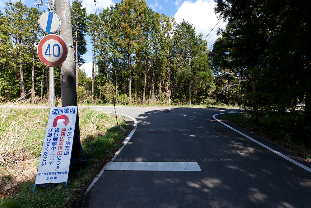 Empty roads and warning signs about radioactivity in the town of Tomioka, Futaba District of Fukushima, Japan. Thursday May 2nd 2013. The town was evacuated on March 12th after the March 11th 2011 earthquake and tsunami cause meltdowns at the nearby Fukushima Daichi nuclear power station. It lies well within the 20 kms exclusion zone though parts of the town were opened in spring 2013 again to allow locals to visit their property during daylight hours.