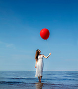 Artist Rebecca Rebouche and a red balloon on the Mandeville lakefront at Fontainbleau State Park on Sunday, August 13, 2017. (Photo by Chris Granger, NOLA.com | The Times-Picayune)