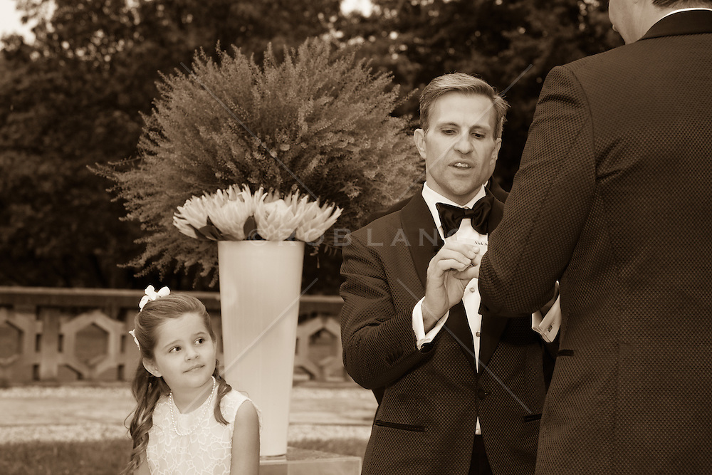 gay couple getting married and little girl watching