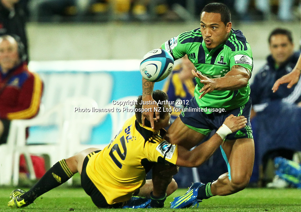 Highlanders' Hosea Gear offloads in the tackle during the 2012 Super Rugby season, Hurricanes v Highlanders at Westpac Stadium, Wellington, New Zealand on Saturday 17 March 2012. Photo: Justin Arthur / Photosport.co.nz