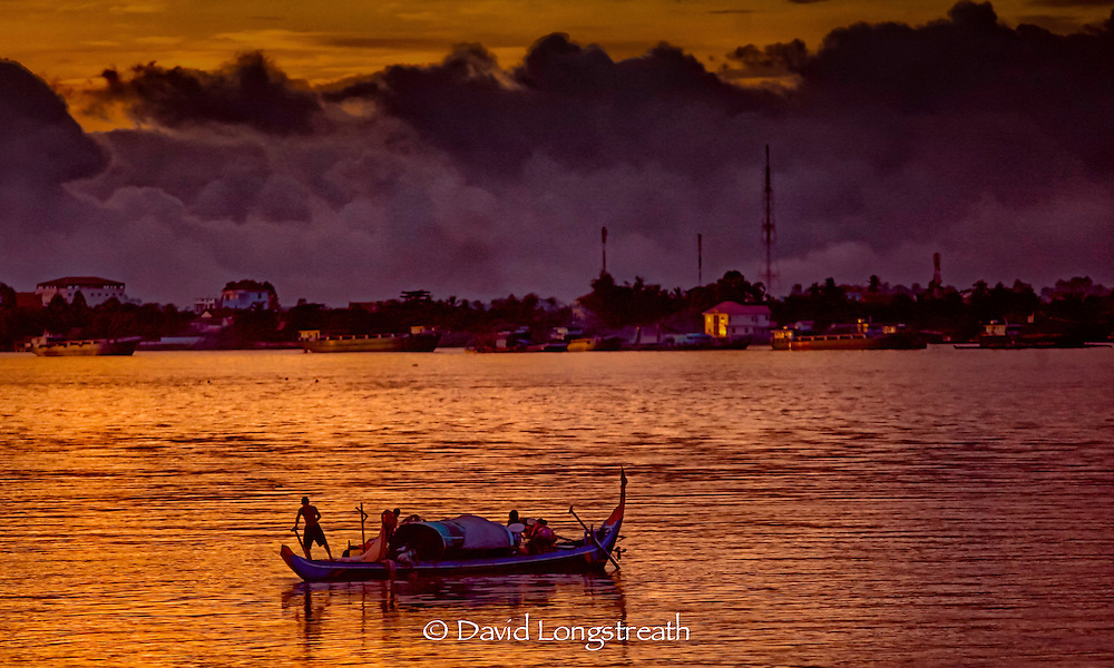 """In this """"Signature Series"""" image by David Longstreath fishermen are seen early morning on the Mekong River near Phnom Penh."""