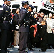 Skyler Brown, Rosa Parks Great Nephew salutes  a member of the Honor Guard before her funeral Services at the AME Church in Washington, D.C.