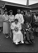 Historic Wedding Bells For Disabled Couple,  (N81)..1981..20.06.1981..06.20.1981..20th June 1981..Happy wedding bells chimed today for the first disabled couple in residential care to marry in the Republic of Ireland. The happy couple are Marie Skully and Pat Linehan and they were married in a special ceremony in The Cara Cheshire Home in the Phoenix Park. Both Marie and Pat are confined to wheelchairs because of their disabilities. After honeymoon, they will make their home in specially adapted quarters within the Cheshire residence..The happy couple pose for pictures with the priest,bridesmaids and groomsmen..If you know the names of the priest and family members why not let us know and we will add them to the caption.