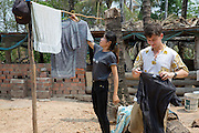 ICS volunteers Dan Hensman & Sokuntheary Nhel hanging their clothes to dry after hand washing in the yard of their host home, in the village of in Banteay Char, near Battambang, Cambodia.
