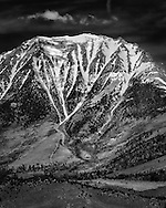 There are many adjectives that have been used to describe the Eastern Sierra range in California. Majestic is one of them that I find very appropriate for its snow-capped peak. I was pretty much inspired by Mitch Dobrowner when creating this image. Mt Gibbs at the Sierra describes this feeling best to me. My goal is to translate its grandeur a range of tonal variation in a B&W rendition.