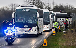 © Licensed to London News Pictures. 31/01/2020. Brize Norton, UK. Coaches carrying passengers leave the airport with a police escort, after a plane carrying British Nationals from Wuhan in China to the UK landed at RAF Brize Norton in Oxfordshire. The flight, carrying 83 Britons and 27 foreign nationals from the centre of the coronavirus outbreak, was initially delayed because of a lack of clearance by Chinese Authorities. Photo credit: Ben Cawthra/LNP