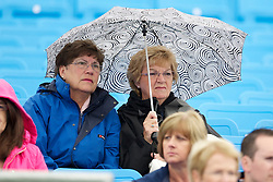 LIVERPOOL, ENGLAND - Thursday, June 16, 2011: Spectators shelter from the rain during day one of the Liverpool International Tennis Tournament at Calderstones Park. (Pic by David Rawcliffe/Propaganda)