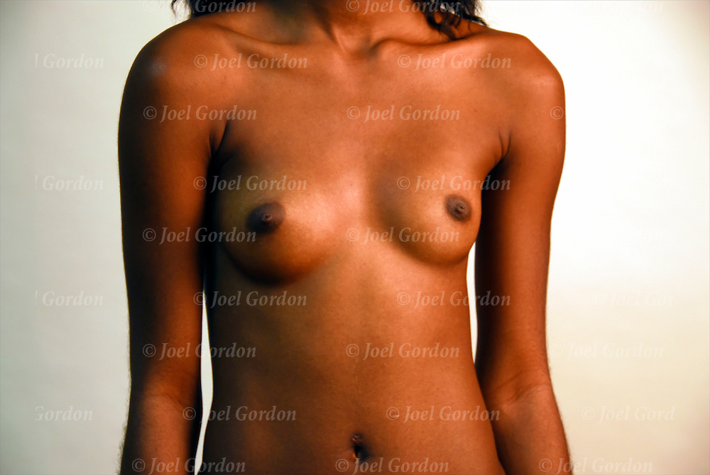Nude African-American woman with smalll size and shape of breasts and nipples,..female breasts vary in size and shapes
