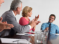 Businesspeople applauding in conference meeting