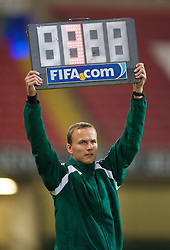 CARDIFF, WALES - Saturday, October 11, 2008: The FIFA fourth official hold up a board to indicate three minutes of extra time during the 2010 FIFA World Cup South Africa Qualifying Group 4 match between Wales and Liechtenstein at the Millennium Stadium. (Photo by David Rawcliffe/Propaganda)