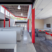 Modern office interior with red columns