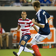 May 26 2012: USA's Landon Donovan (10) kicks the ball over Scotland's Andy Webster (4) during the first half of play of the U.S. Men's National Soccer Team game against Scotland at Everbank Field in Jacksonville, FL. At halftime USA lead Scotland 2-1.