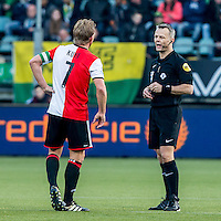 DEN HAAG - ADO Den Haag - Feyenoord , Voetbal , Eredivisie , Seizoen 2016/2017 , Kyocera Stadion , 19-02-2017 , Feyenoord speler Dirk Kuyt (l) in gesprek met scheidsrechter Bjorn Kuipers (r)