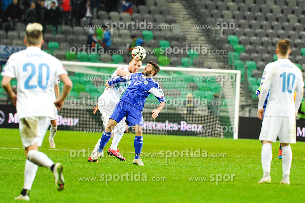 Jasmin Kurtic of Slovenia vs Alessandro Golinucci of San Marino during football match between NationalTeams of Slovenia and San Marino in Round 5 of EURO 2016 Qualifications, on March 27, 2015 in SRC Stozice, Ljubljana, Slovenia. Photo by Mario Horvat / Sportida