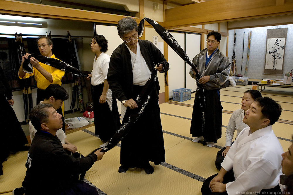 Yabusame archers preparing bows and arrows for the Yasame ritual that will be performed the next day in Tado shrine.