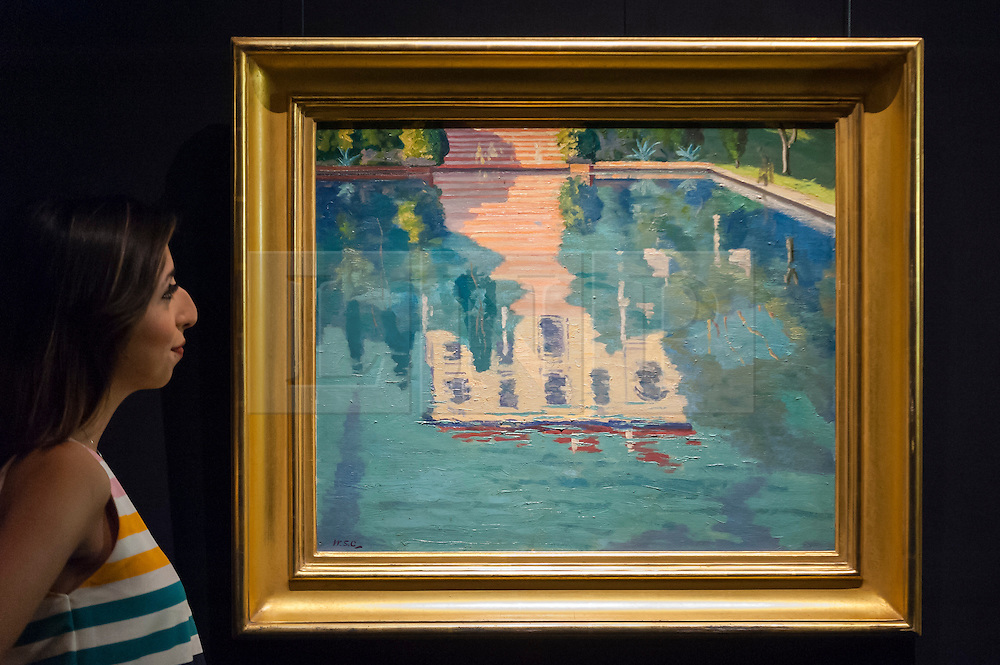 """© Licensed to London News Pictures. 18/11/2016. London, UK. A staff member views """"Les Zoraïdes on Cap Martin"""" by Sir Winston Churchill (est. GBP100-150k), at the preview at Sotheby's of works on view at four upcoming November auctions featuring Modern & Post-War British Art, A Painter's Paradise (Julian Trevelyan & Mary Fedden at Durham Wharf), Scottish Art and Picasso Ceramics from the Lord & Lady Attenborough Private Collection. Photo credit : Stephen Chung/LNP"""