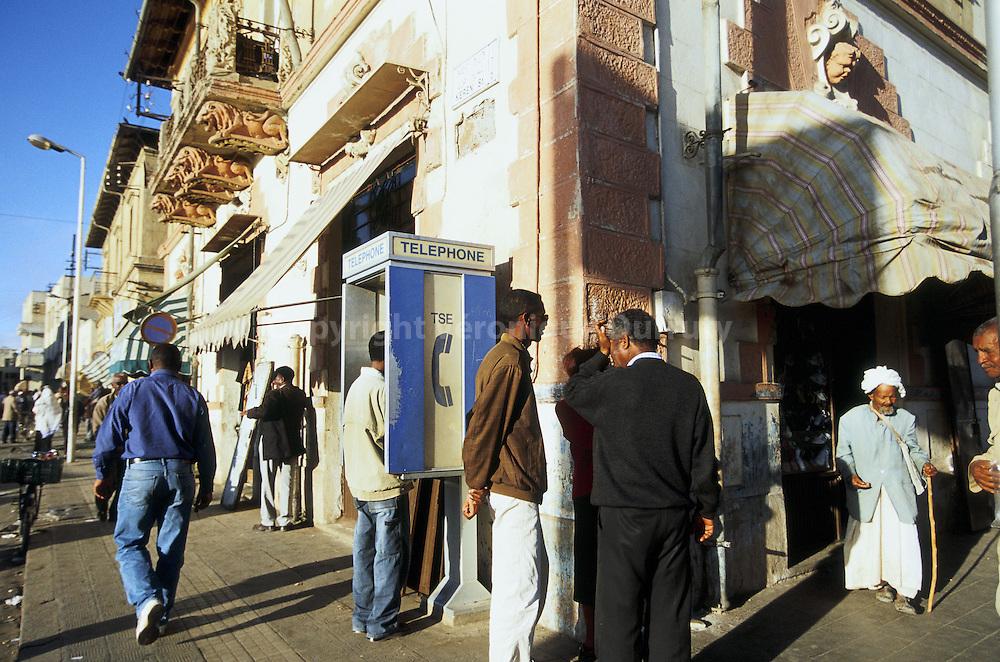 """Street scene in Asmara, Eritrea // Asmara est la capitale et la plus grande ville de l'Érythrée. Sa population est d'environ 500,000 habitants.Asmara se forma à partir de quatre villages au XIIe siècle comme relais. Elle devint plus tard la capitale du prince Ras Alula. Elle fut colonisée par l'Italie en 1889 et devint la capitale nationale en 1897. Vers la fin des années 30, les italiens modifièrent profondément la ville avec un nouvel ordonnancement et de nouveaux bâtiments; Asmara était appelée """"Piccola Roma"""" (la petite Rome). De nos jours, la plupart des bâtiments sont d'origine italienne."""
