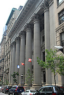 Flags fly on the Canadian Bank of Commerce (CIBC) building in Vieux-Montreal, the historic old city center, of Montreal, Canada. (Photo by Phelan M. Ebenhack)